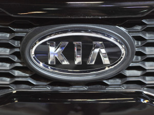 The logo for Kia on display at the Chicago Auto Show