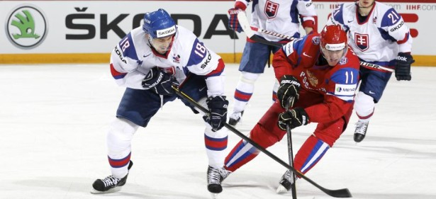 HELSINKI, FINLAND - MAY 20: Russia's Yevgeni Malkin #11 steals the puck from Slovakia's Miroslav Satan #18 during gold medal game action at the 2012 IIHF World Championship. (Photo by Andre Ringuette/HHOF-IIHF Images)